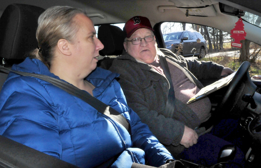 Kennebec Valley Community Action Program volunteer driver John Bryant chats with client Jewel York while driving her to work Thursday in Waterville.