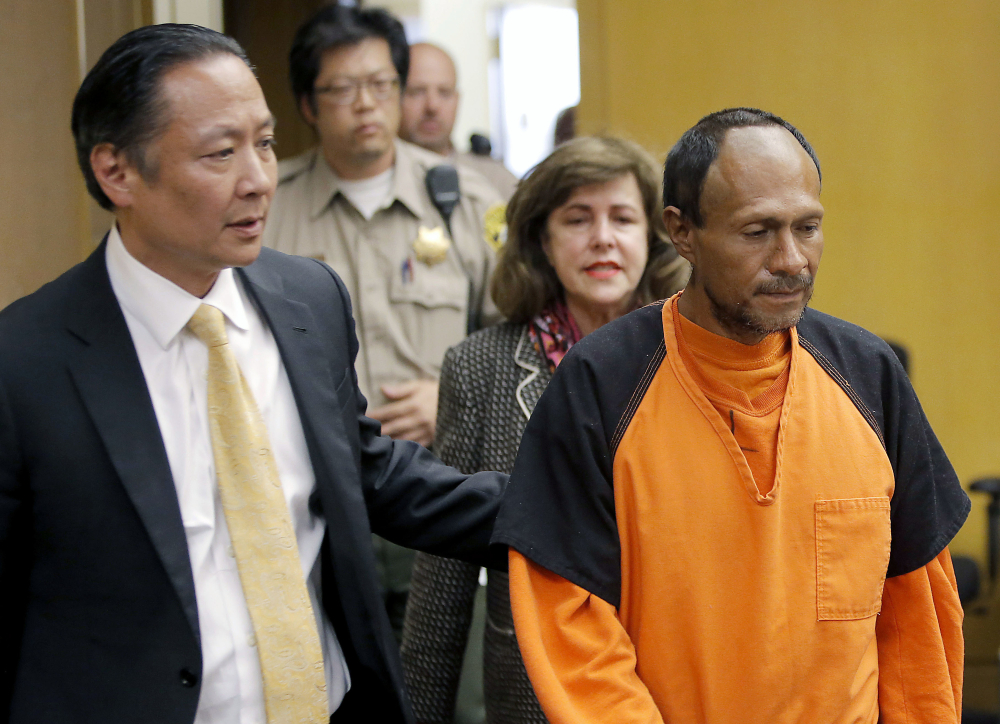 Jose Ines Garcia Zarate, right, is led into the courtroom by San Francisco Public Defender Jeff Adachi, left, and Assistant District Attorney Diana Garciaor for his arraignment on July 7, 2015. A jury acquitted him in November on possible charges ranging from involuntary manslaughter to first-degree murder.