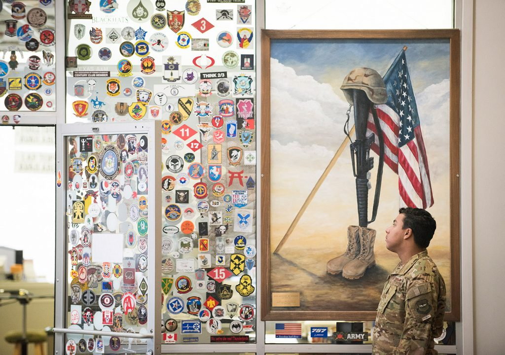 Senior Airman Perry Lopez of McChord Air Force Base in Washington state looks at the memorabilia left by traveling servicemen and women at the Maine Troop Greeters room at the Bangor International Airport.More than 1.5 million troops have passed through Bangor on military flights to and from Iraq, Afghanistan and other overseas destinations.