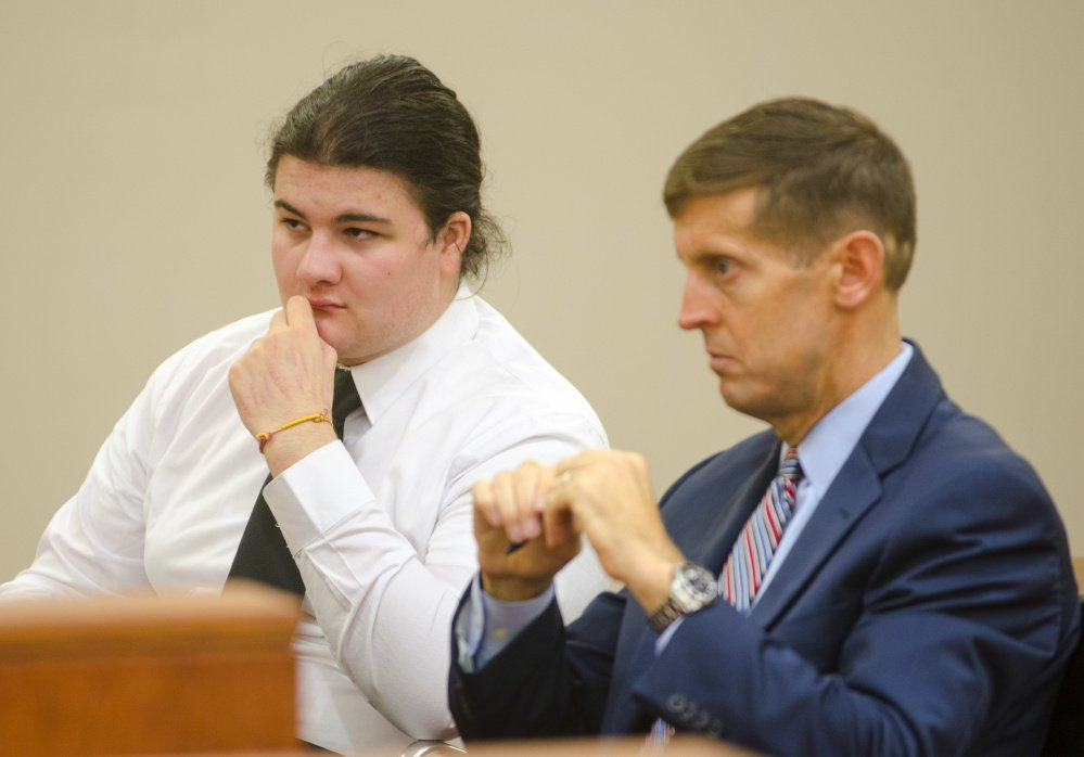 Andrew Balcer, left, sits with his attorney Walter McKee during a hearing Oct. 26 at the Capital Judicial Center in Augusta. On Thursday, a judge ruled he should be tried as an adult on charges that he murdered both his parents last year in their Winthrop home.