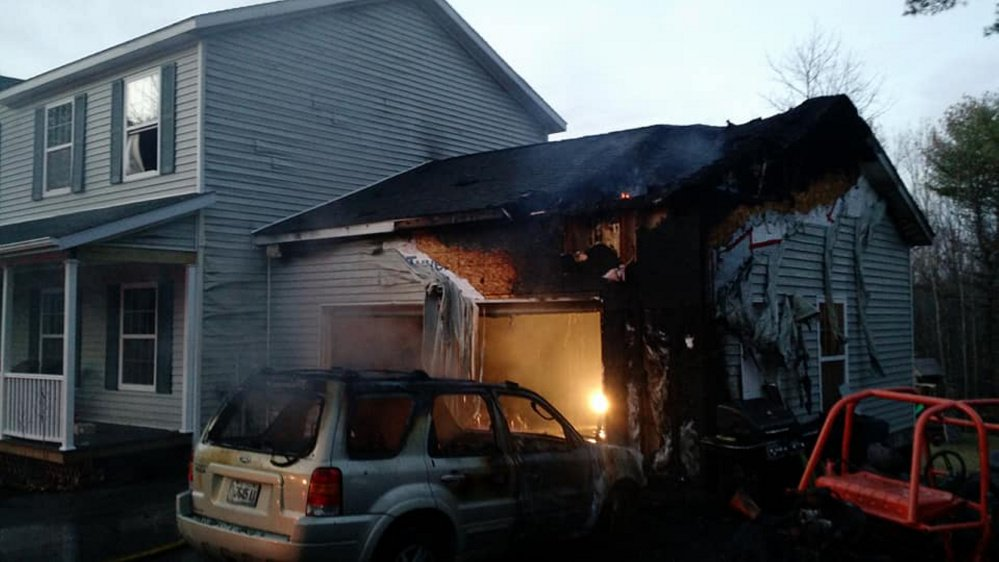 A garage on Red Maple Lane was significantly damaged Tuesday, but quick thinking by an Augusta firefighter kept the fire from spreading to the home.