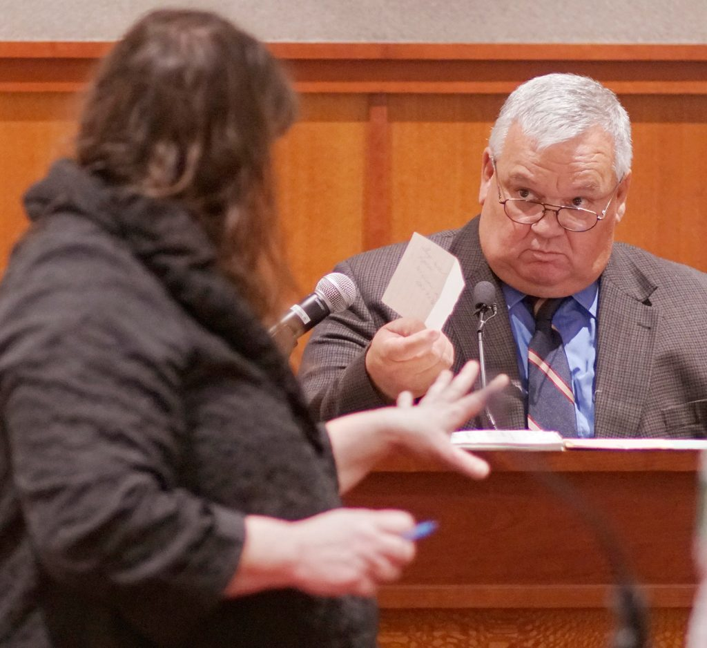 Former Portland detective Daniel Young looks for clarification from attorney Amy Fairfield on Thursday during the post-conviction review for Anthony Sanborn. Young was one of two primary detectives who investigated the murder of Jessica Briggs in 1989. Sanborn was convicted in 1992 of killing Briggs and served 27 years in prison until he was released on bail in April after one of the state's key eyewitness recanted.