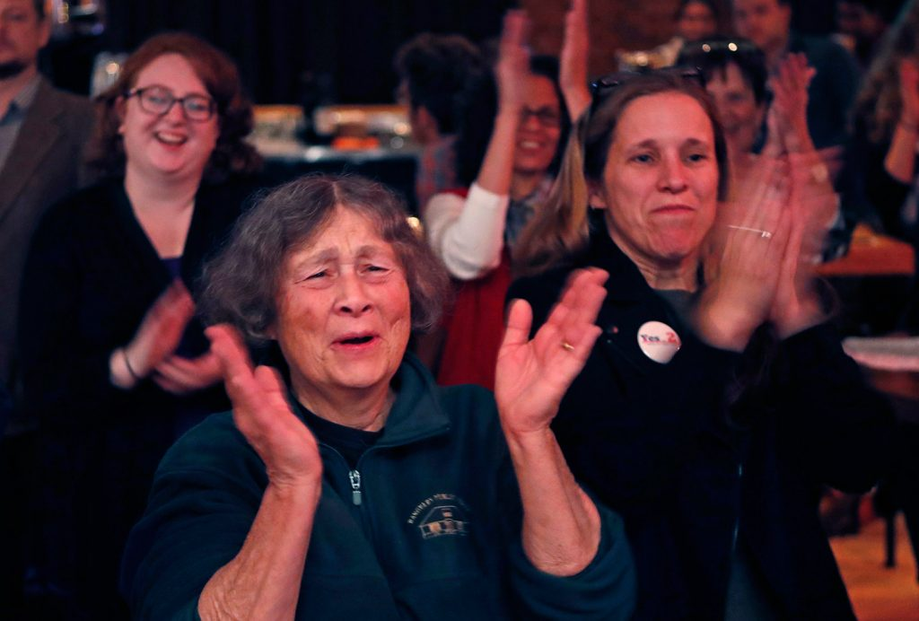Supporters of Medicaid expansion cheer on Election Day in November while awaiting results at the Mainers for Health Care party in Portland. Voters decided to join 31 other states and expand Medicaid under the Affordable Care Act, but Gov. Paul LePage has insisted that the Legislature fund expansion costs without tapping into the state's rainy day fund or increasing taxes.