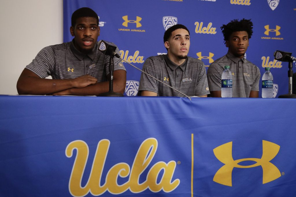 UCLA basketball player Cody Riley, left, reads his statement as he is joined by teammates LiAngelo Ball, center, and Jalen Hill during a news conference at UCLA Wednesday in Los Angeles. Three UCLA NCAA college basketball players accused of shoplifting in China admitted to the crime and apologized before Coach Steve Alford announced they were being suspended indefinitely.