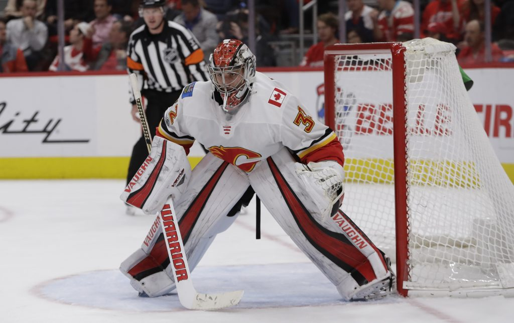 Calgary Flames goalie Jon Gillies of South Portland watches the play during the second period Wednesday night in Detroit.