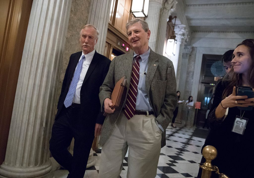 U.S. Sen. Angus King, I-Maine, left, and Sen. John Kennedy, R-La., arrive for votes on Capitol Hill in Washington on Monday. On Thursday, King tried to send the Republican tax plan back to a Senate committee, but his motion failed on a party-line vote.