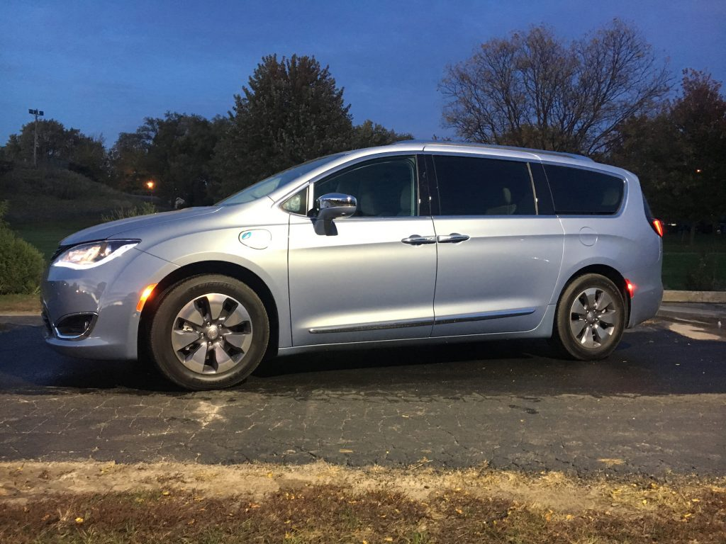 The 2017 Chrysler Pacifica plug-in hybrid minivan has a 33-mile electric range and total range of 566 miles when powered by the 3.6-liter V-6 engine. Pictured in Platinum trim.