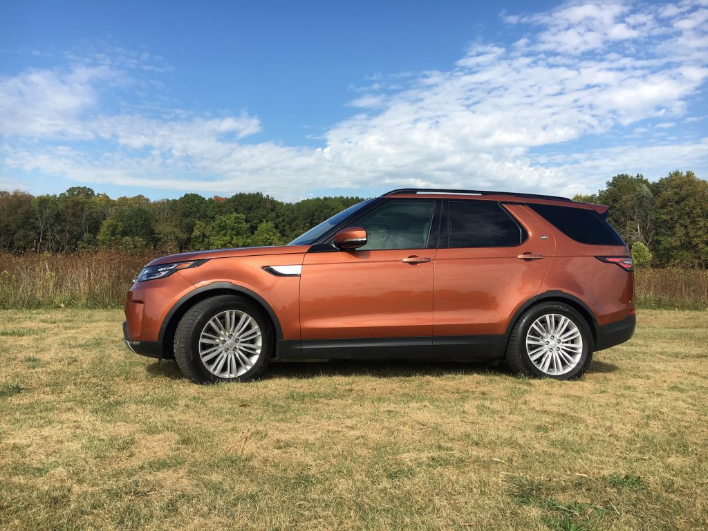 The fifth-generation 2017 Land Rover Discovery in Namib Orange is a luxury three-row SUV powered by a V-6 diesel engine with all sorts of technological conveniences that help define luxury.