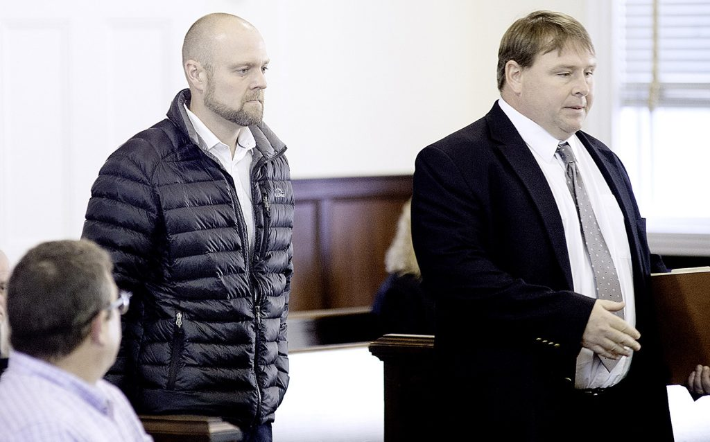 Robert Trundy, left, enters the Oxford County Superior Court with his attorney, Scott Lynch, in Paris on Wednesday.
