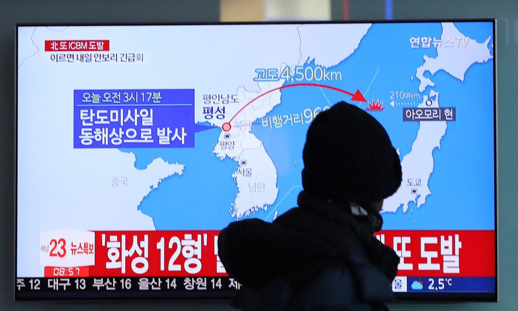A man watches a TV screen showing a local news program reporting North Korea's missile launch at the Seoul Train Station in Seoul, South Korea, on Wednesday.