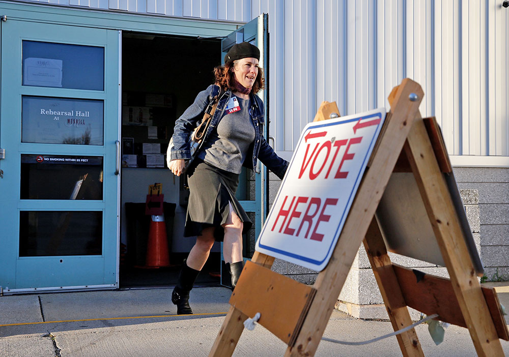 Rosemary Warnock, a registered nurse at Maine Health, leaves the Merrill Auditorium voting station early on Tuesday after casting her ballot. Warnock said she was particularly motivated to vote in favor of MaineCare expansion and oppose the casino proposal.