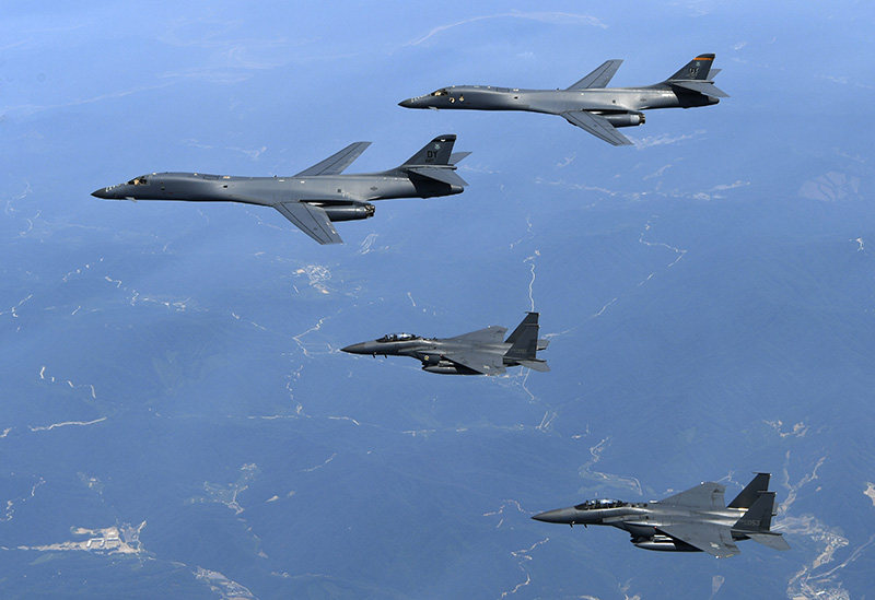 U.S. Air Force B-1B bombers, top, and second from top, and South Korean fighter jets F-15K fly over the Korean Peninsula, South Korea in June 2017.