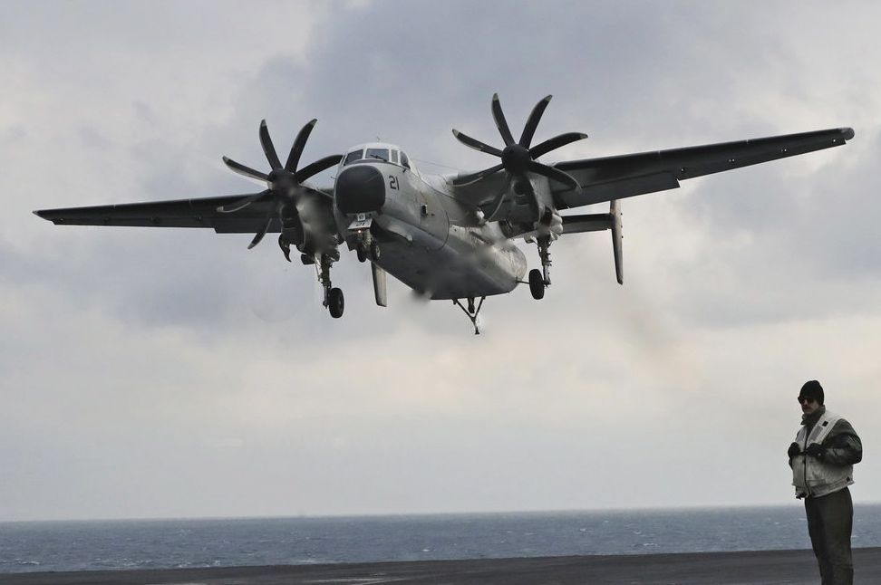 A U.S. Navy C-2 Greyhound of the kind that crashed in the Pacific with 11 aboard on Wednesday morning approaches the deck of the Nimitz-class aircraft carrier USS Carl Vinson during a military exercise in March.
