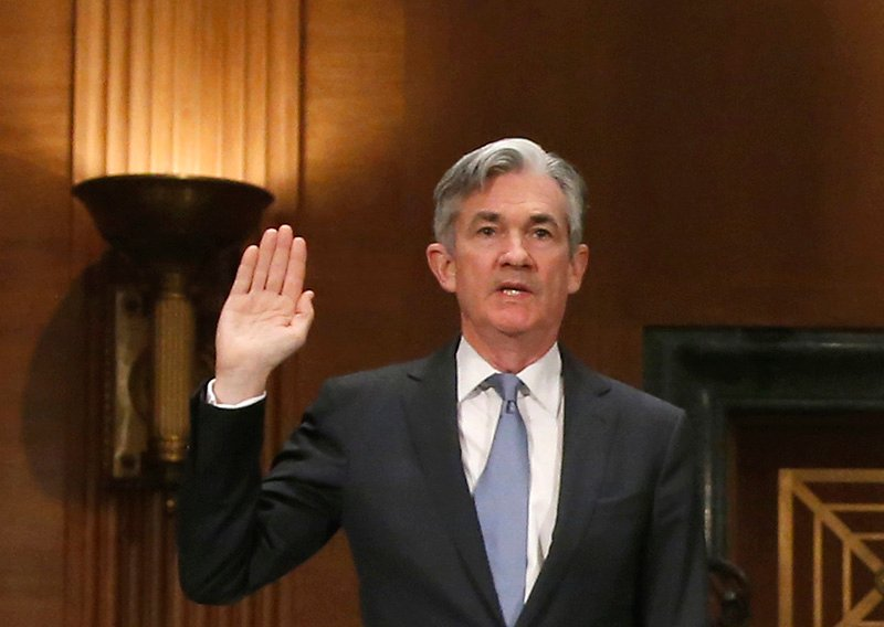 Jerome H. Powell is sworn in prior to testifying before the Senate Banking Committee hearing on his nomination in 2014.