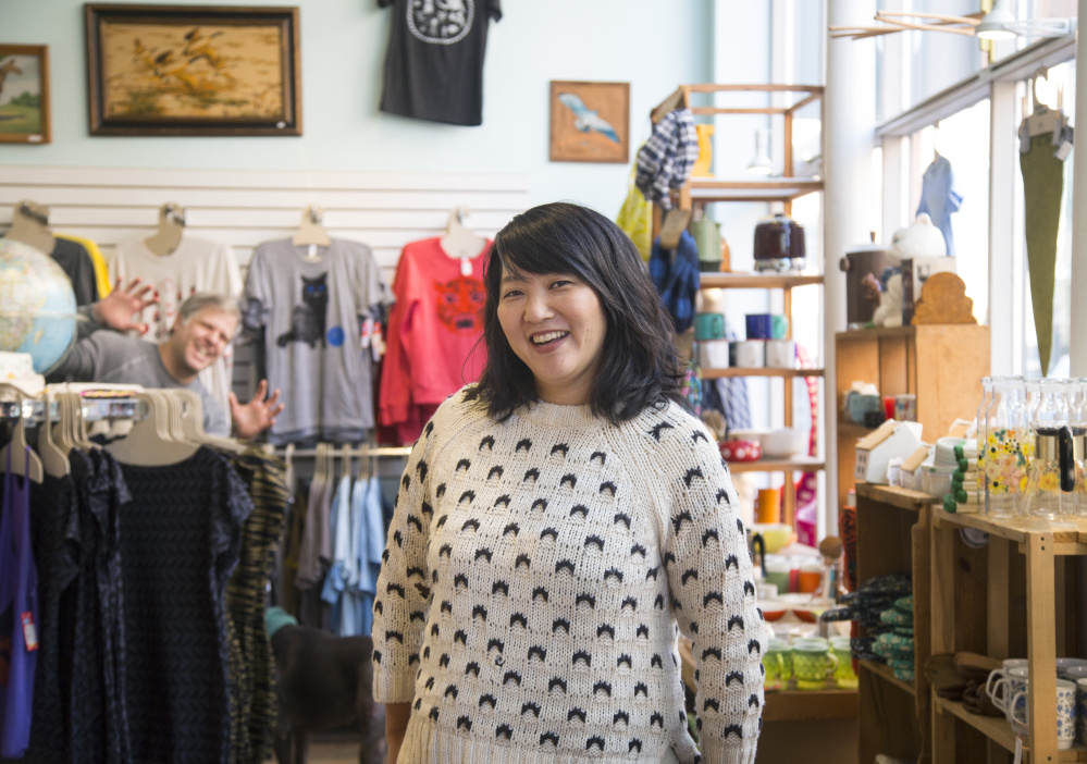 Amy Teh, one of the founders of Picnic, a craft show in Portland that showcases Maine makers. Popping out in the background is Noah DeFilippis, Teh's partner and another founder of Picnic.