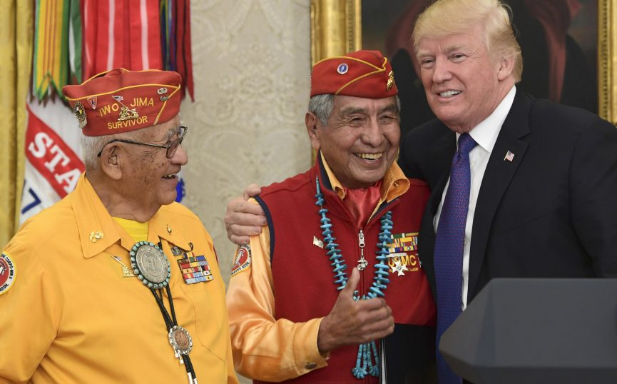 President Trump, right, meets with Navajo Code Talkers Peter MacDonald, center, and Thomas Begay, left, in the Oval Office of the White House. MacDonald said America's diversity makes us strong.