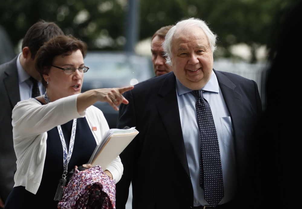 Russian Ambassador to the U.S. Sergey Kislyak, right, arrives at the State Department on July 17. Court documents filed Friday show that Michael Flynn did not operate independently in his contacts with Kislyak.