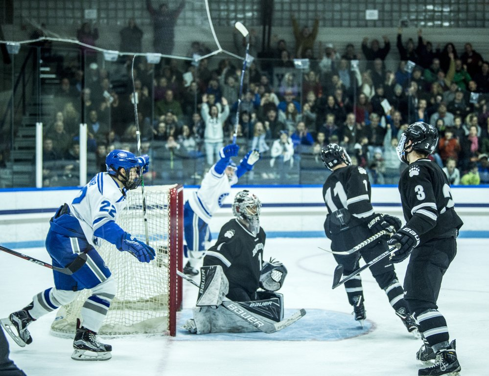 Colby players celebrate a first-period goal by Kienan Scott during their 4-2 win over Bowdoin.