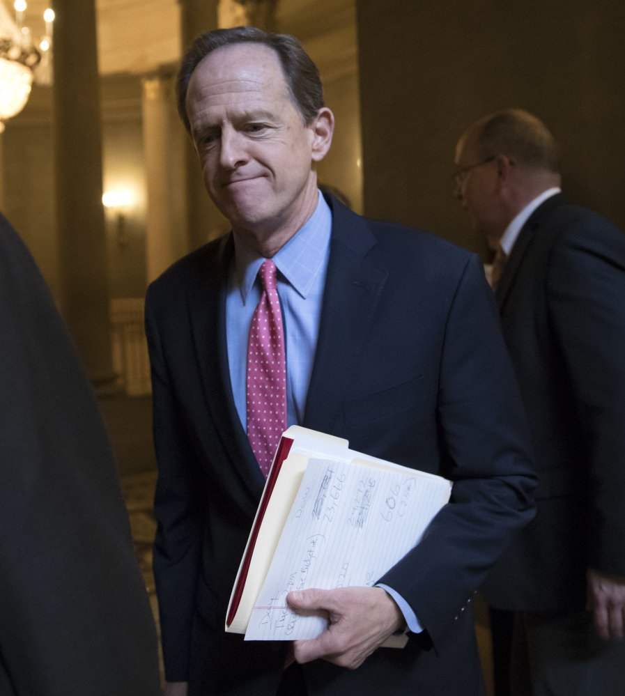 Sen. Pat Toomey, R-Pa., defended a tax break for Hillsdale College, which has a connection with the DeVos family.