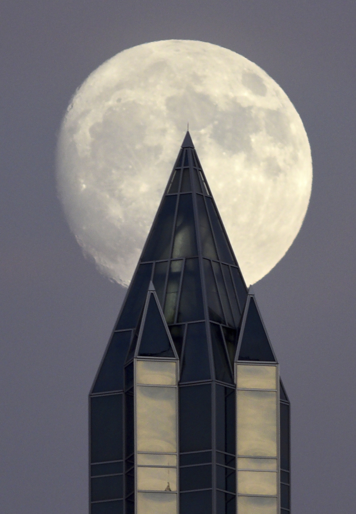 December's nearly full moon rises over Pittsburgh on Friday.