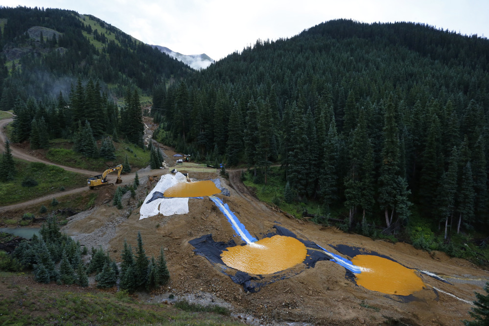 Water flows through a series of retention ponds built to contain and filter out heavy metals and chemicals from the Gold King mine chemical accident, in Silverton, Colo.