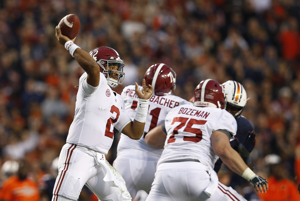 Alabama quarterback Jalen Hurts throws the ball during the second half of the Iron Bowl in Auburn, Ala. Despite losing to Auburn — which lost to Georgia in the SEC title game — the Crimson Tide were selected for the NCAA football playoff.