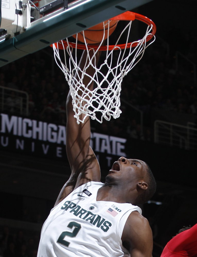 Jaren Jackson Jr. of Michigan State finds room inside to dunk against Jordy Tshimanga of Nebraska during Michigan State's 86-57 victory,