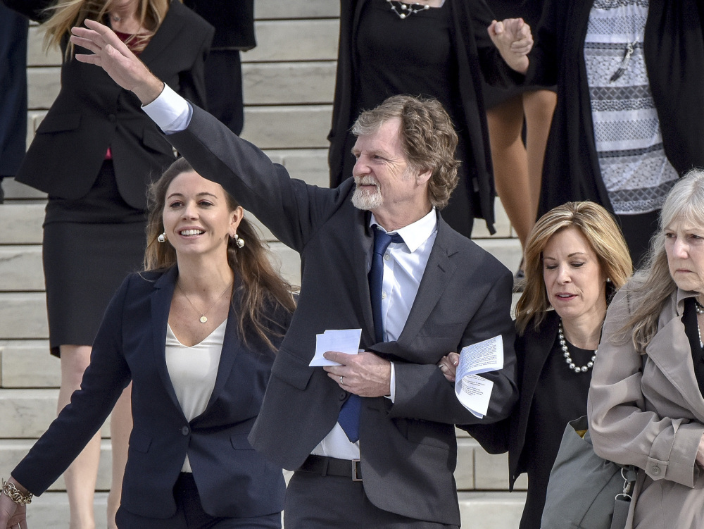 Jack Phillips, the baker who refused to make a cake for a gay couple, waves outside the Supreme Court on Tuesday.