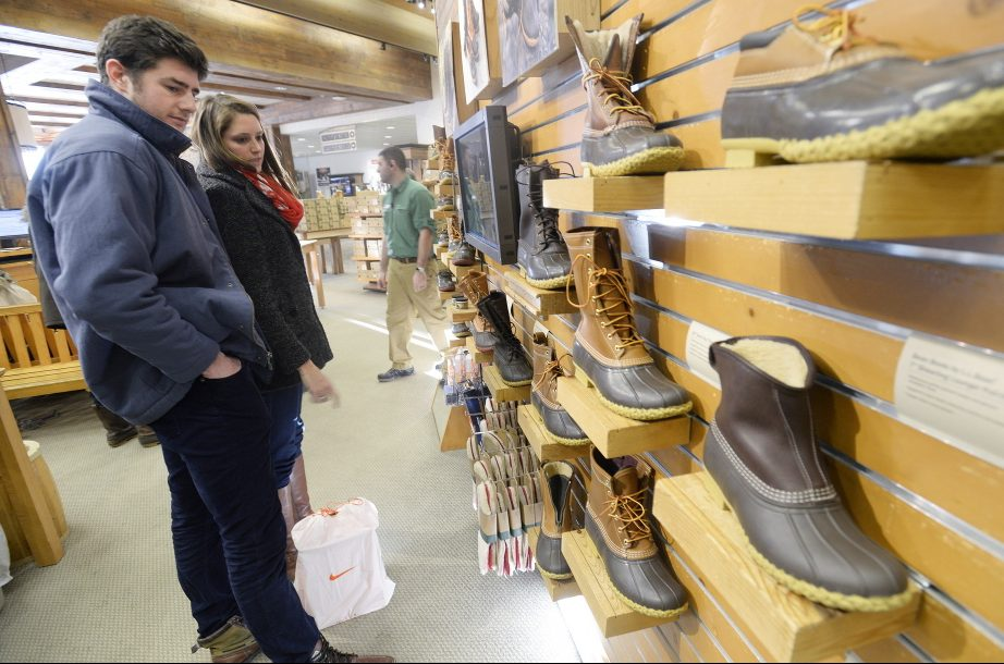 Patrons look at boots at the L.L. Bean store in Freeport. Sales of Bean boots have broken records.