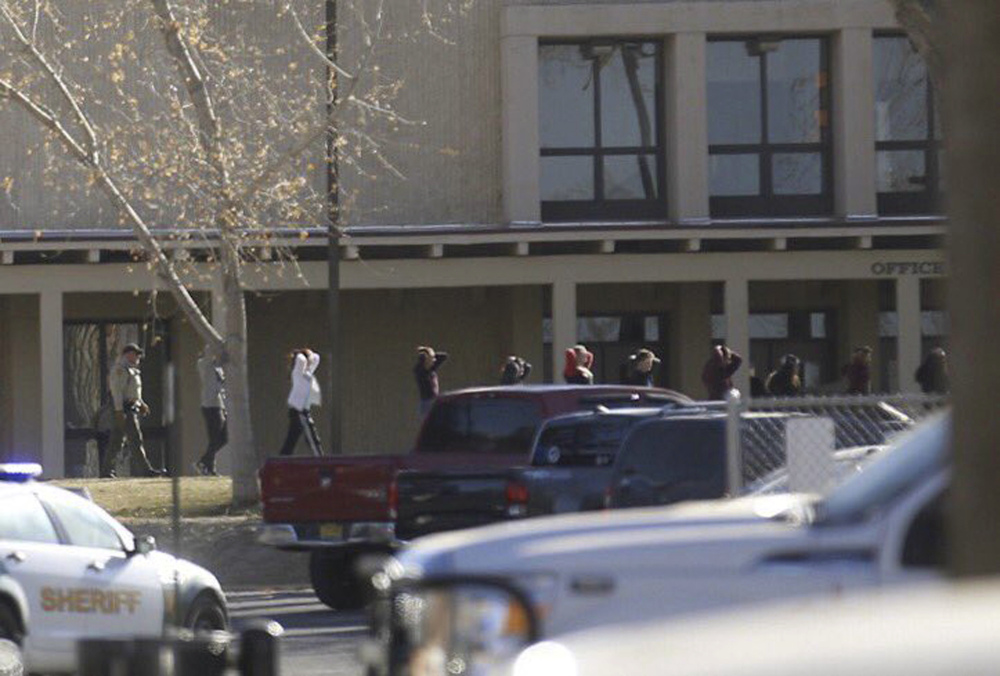 Students are led out of Aztec High School after a shooting Thursday in Aztec, New Mexico. The school is in the Four Corners region and is near the Navajo Nation.