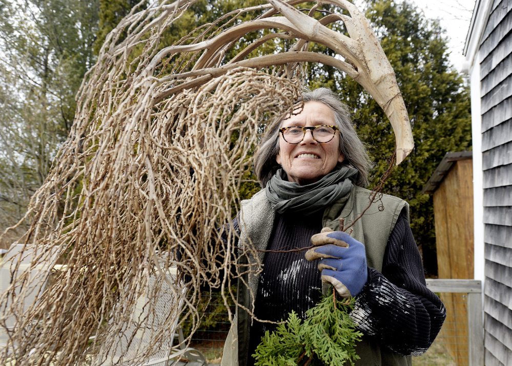 Diane Walden, a Coastal Maine Botanical Gardens horticulturist, uses blown-down branches and found objects as much as possible for wreaths.