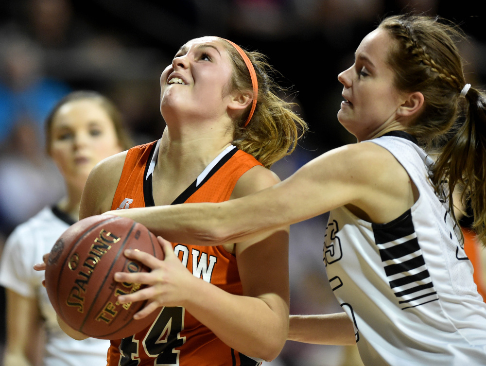 Keep away: Winslow guard Weslee Littlefield, left, draws a foul from Houlton's Megan Collett during a Class B North semifinal last season at the Cross Insurance Center in Bangor.
