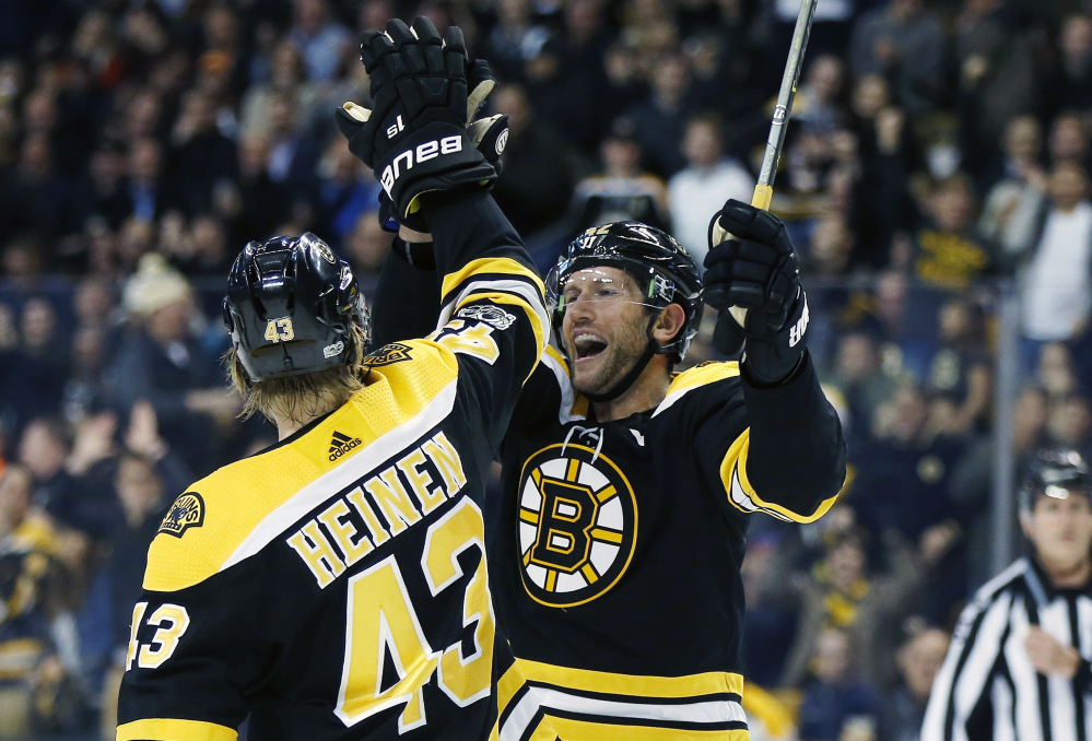 Boston's David Backes celebrates his goal with Danton Heinen in the second period Thursday night against the Arizona Coyotes at Boston.