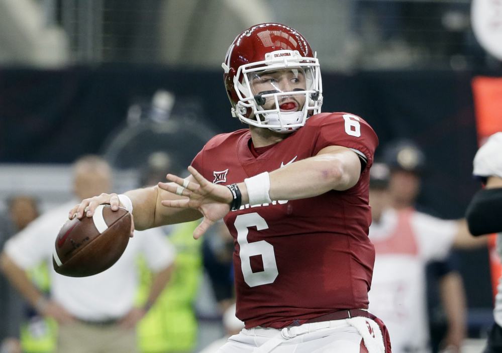 In this Dec. 2, 2017, file photo, Oklahoma quarterback Baker Mayfield (6) throws a pass in the first half of the Big 12 Conference championship NCAA college football game against TCU  in Arlington, Texas. Mayfield, reigning Heisman winner Lamar Jackson of Louisville and Stanford running back Bryce Love were chosen as finalists for the Heisman Trophy on Monday, Dec. 4, 2017.