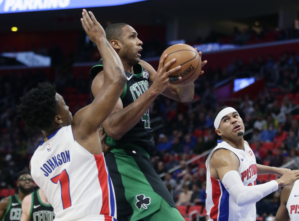 Boston forward Al Horford drives to the hoop against the Pistons' Stanley Johnson (7) and Tobias Harris on Sunday afternoon in Detroit. Horford had 18 points in Boston's 91-81 victory.