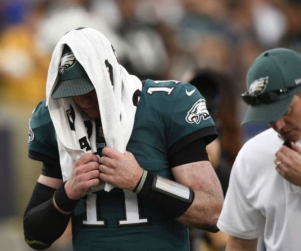 Eagles quarterback Carson Wentz leaves the field during the second half of Philadelphia's win against the Rams on Sunday in Los Angeles. Sources say Wentz has a torn left ACL.