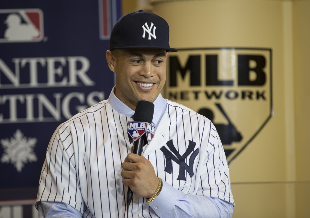 Giancarlo Stanton, who hit 59 home runs last season, has not played for a team that finished the season with a winning record in his eight-year career. On Monday, he officially joined the Yankees, who played in Game 7 of the ALCS in 2017.