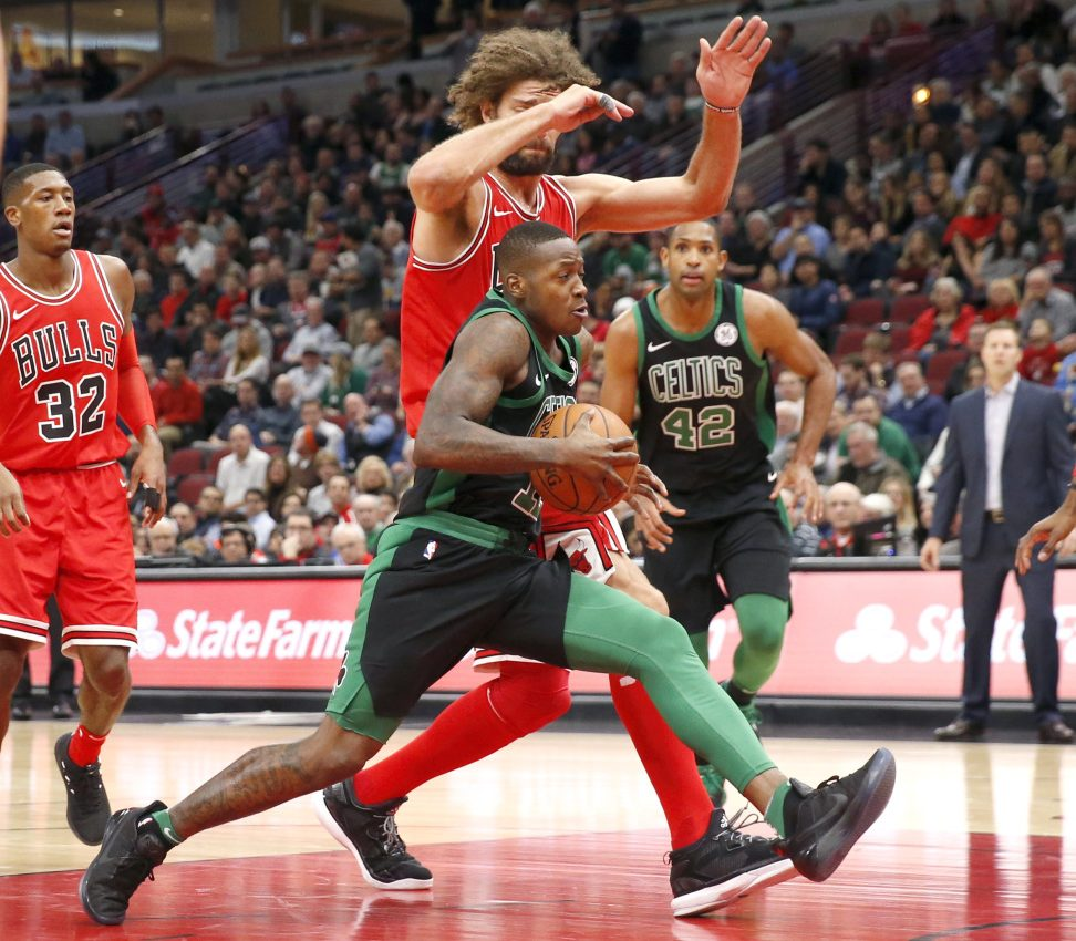 The Celtics' Terry Rozier drives past the Bulls' Robin Lopez in the first half of Monday night's game in Chicago.