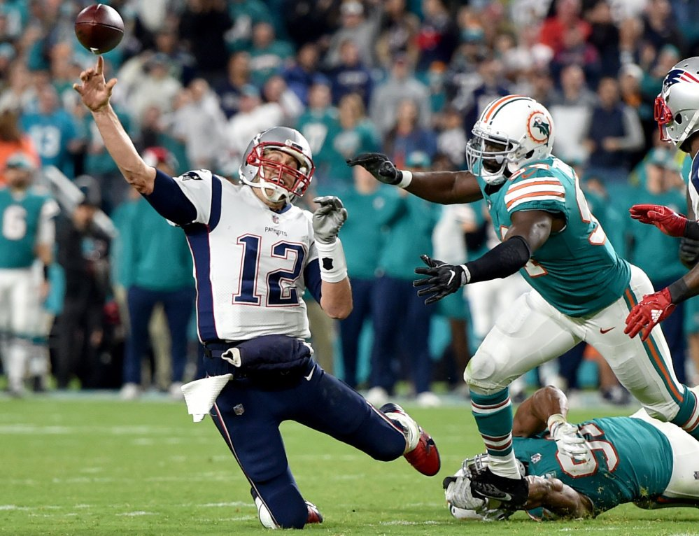 New England quarterback Tom Brady was under pressure all night long in a 27-20 loss at Miami on Monday.