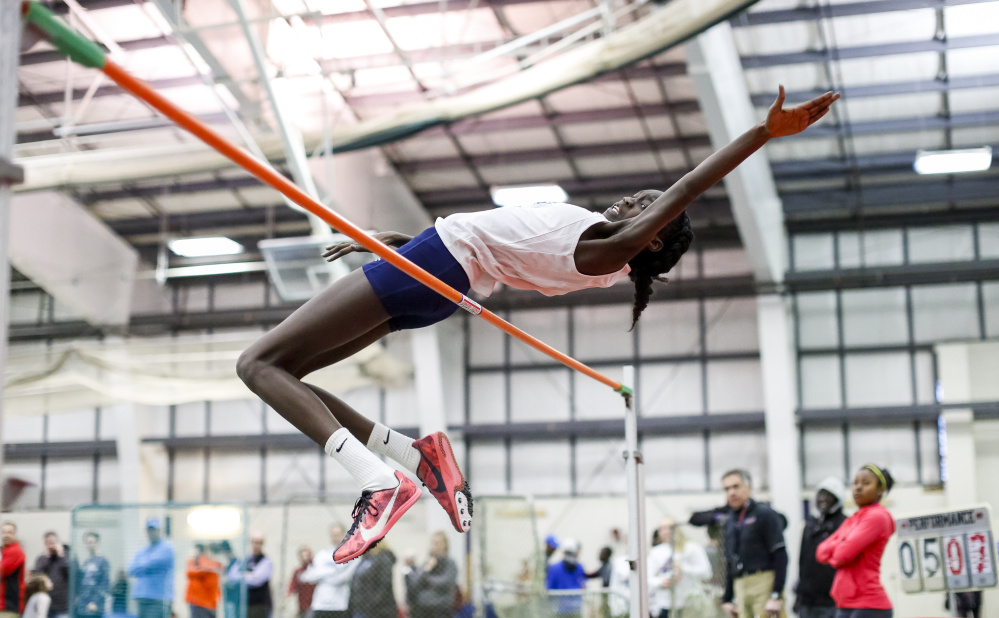 Nyagoa Bayak, a Westbrook High junior, is back to defend her Class A state titles in the high jump and triple jump.
