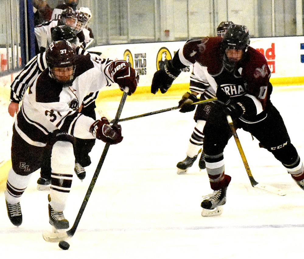 Colin Merritt of Edward Little brings the puck down the ice ahead of Jack Richards of Gorham during the Eddies' 4-1 victory Wednesday night in a boys' hockey game at the Norway Savings Bank Arena in Auburn.