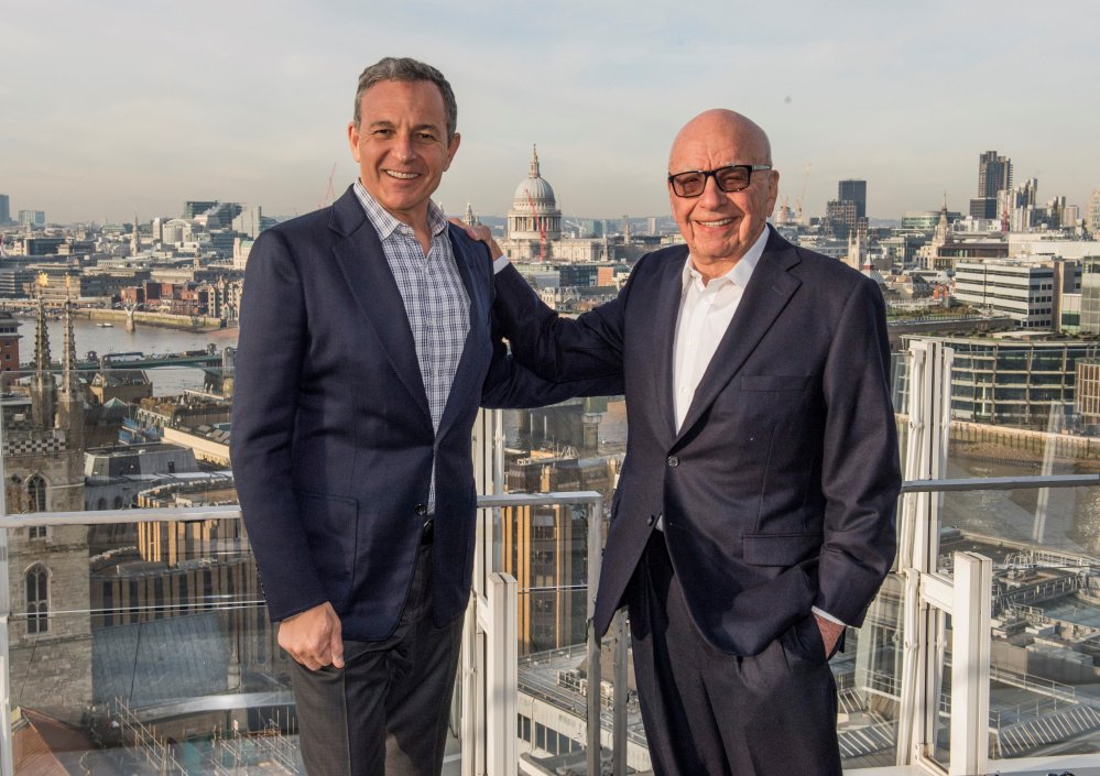 Robert A. Iger, left, chairman and CEO of The Walt Disney Co., and Rupert Murdoch, executive chairman of 21st Century Fox.