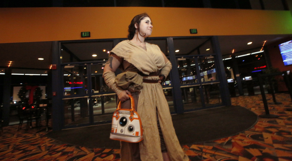 """Dressed as Rey, Lane Boucher of Biddeford arrives at Cinemagic in Westbrook for the opening Thursday of """"Star Wars: The Last Jedi,"""" the eighth episode in the saga. """"I've heard some trepidation out there, but I'm excited,"""" she said. """"I'm not too afraid."""""""