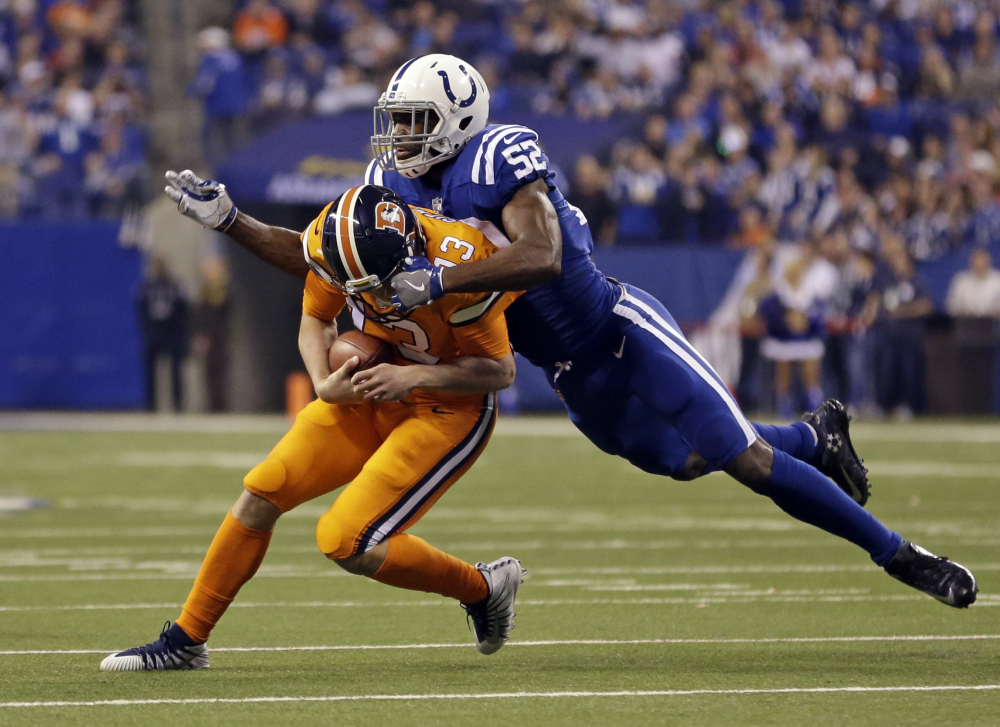 Linebacker Barkevious Mingo of the Indianapolis Colts sacks Denver quarterback Trevor Siemian during the first half of their game Thursday night. The Broncos won, 25-13.