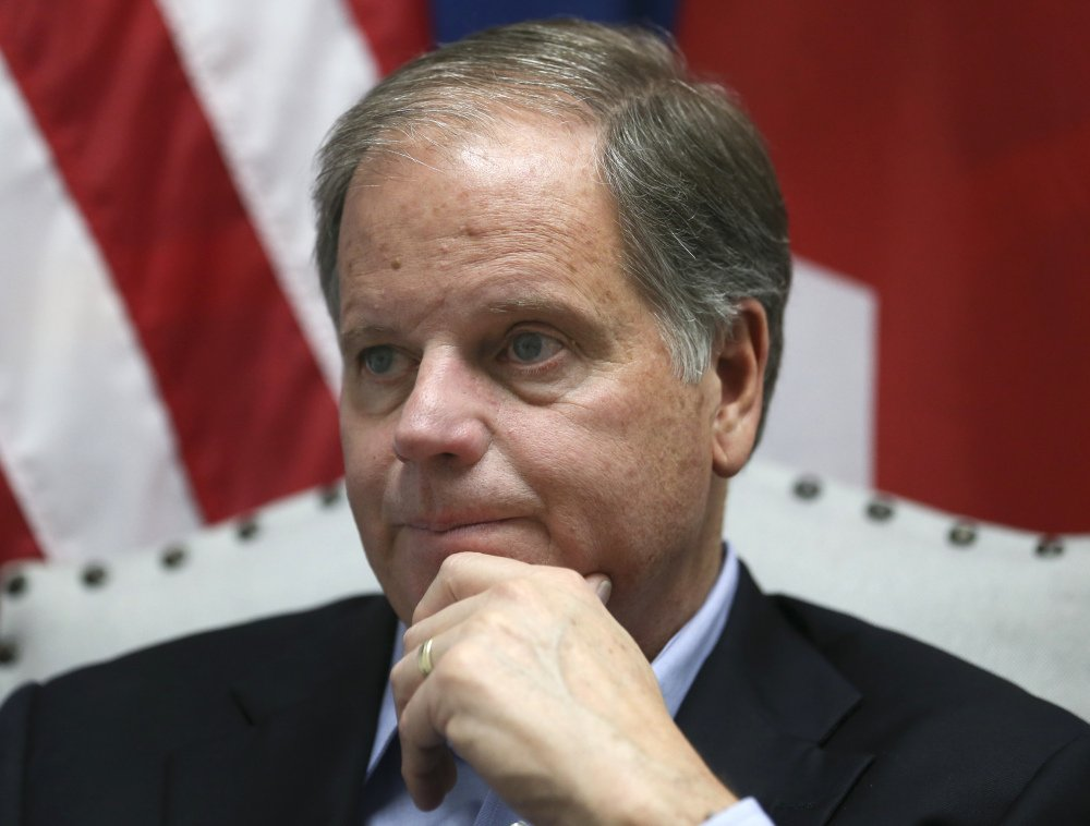 "Democrat Doug Jones speaks during an interview with the Associated Press, in Birmingham, Ala.  Alabama Secretary of State John Merrill dismissed the viral story that over 5,000 of the votes for Jones in Tuesday's special U.S. Senate election were cast by the dead. ""There are not 5,000 dead people on the voters rolls unless they died today,"" Merrill said on Thursday."