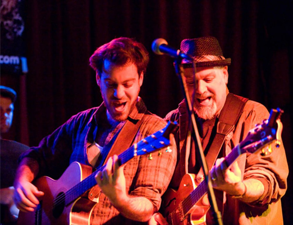 Lyle, left, and his father Phile performing.