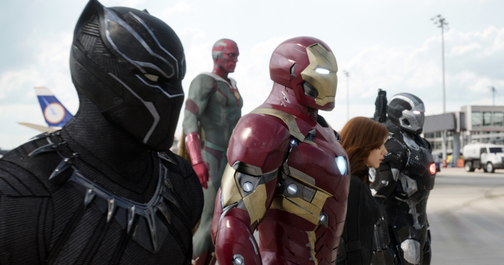 This file image provided by Disney shows, from left, Chadwick Boseman as Panther, Paul Bettany as Vision, Robert Downey Jr. as Iron Man, Scarlett Johansson as Natasha Romanoff, and Don Cheadle as War Machine in a scene from