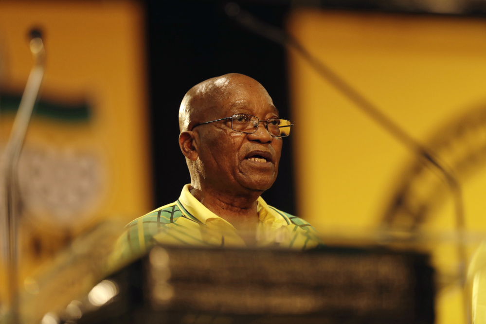 South African President Jacob Zuma addresses the African National Congress, of which he is also president, on Saturday. Zuma admits his scandals have darkened the ANC's future.