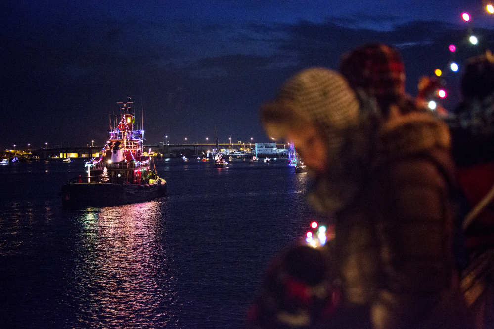 vessels are lit with christmas lights during the annual boat parade of lights in portland harbor seen from the aucocisco ferry on saturday dec 16 2017