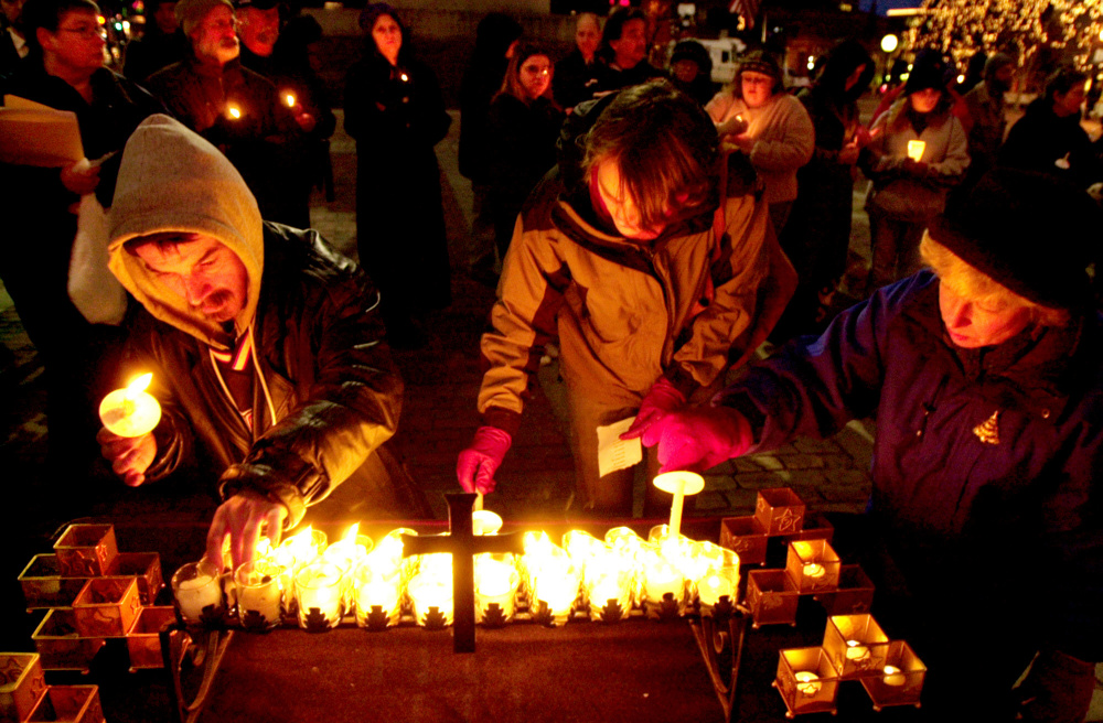 A 2002 vigil in Monument Square remembers the homeless, whose distress, a letter writer says, is a product of our greedy lifestyles.